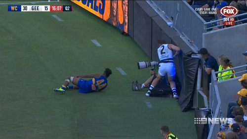 Two Geelong players were left bleeding after they ploughed into LED signs. (9NEWS)