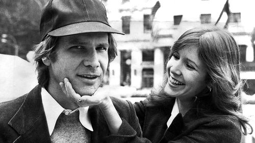Fisher and Ford pictured in New York together during a promotional tour for Star Wars: A New Hope. (Getty)