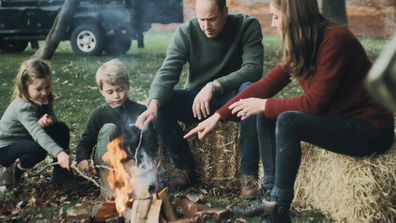 Princess Charlotte, Prince George, Prince William and Kate Middleton roast marshmallows on an open fire