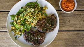 Barbecue scotch fillet marinated with garlic, anchovy and vincotto, served with grilled zucchini, snap peas and corn salad