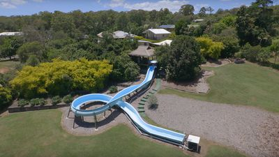 This QLD property has a hairdressing salon and theme-park style waterslide