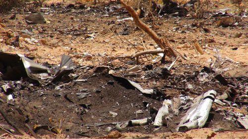 Wreckage at the Mali crash site of flight AH5017.