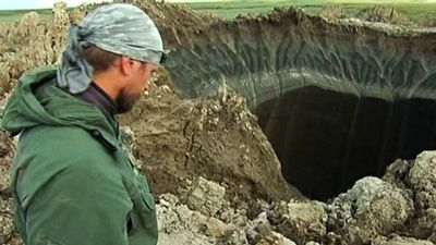 "Back in July, an 80-metre hole opened up seemingly for no reason in Siberia. A number of scientists said it was probably caused by a trapped methane well, but we're pretty sure the scorching identified around the edges of the hole indicates something infernal. (AAP)<br><br><a href=""http://www.9news.com.au/world/2014/07/16/13/28/giant-hole-opens-in-siberia"">READ THE FULL STORY</a>"