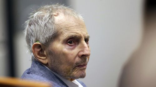 FILE - In this March 10, 2020, file photo, real estate heir Robert Durst looks over during his murder trial in Los Angeles. A judge on Monday, June 14, 2021,  ordered that the murder trial of the multimillionaire real estate heir will continue, despite defense requests for a delay because he's in too much pain. Durst's lawyers argued that he was in such pain from a urinary tract infection and other undiagnosed issues that he couldn't even stand up to to dress for court. (AP Photo/Alex Gallardo,