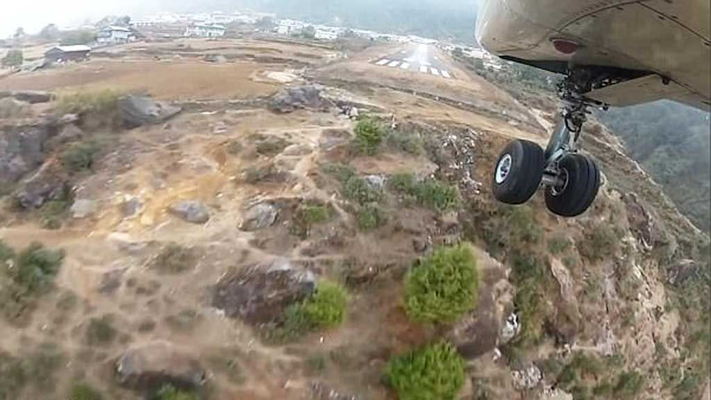 Video of plane landing on world's most dangerous runway in the Himalayas