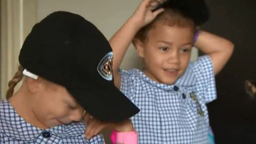 Two of the bubbly King triplets get ready for their big day. (9NEWS)