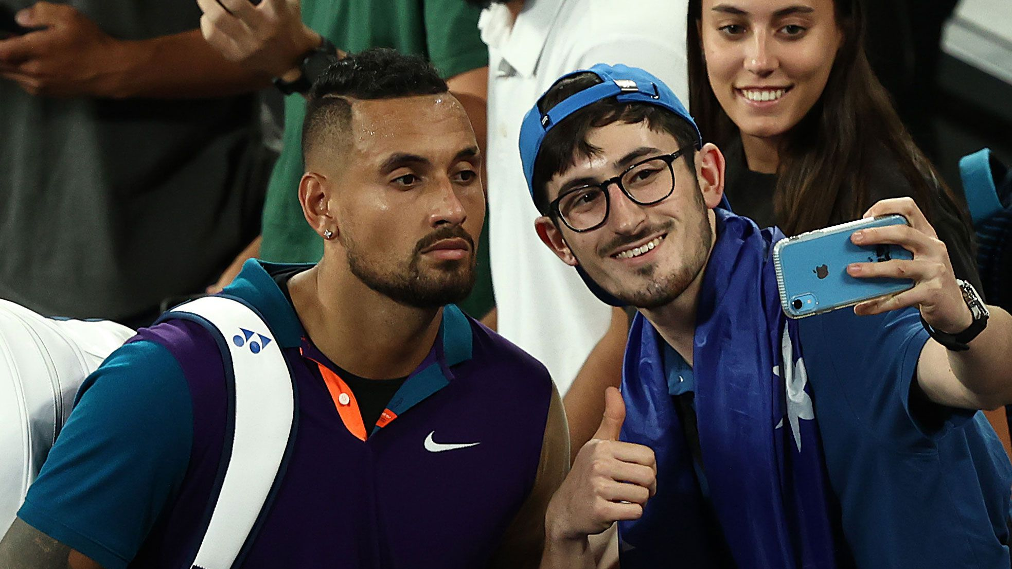 Nick Kyrgios takes a selfie with a fan after his Australian Open win over Ugo Humbert.
