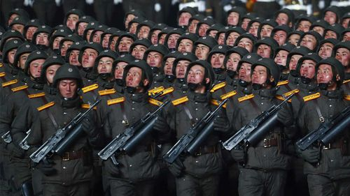 North Korean soldiers march in formation during a military parade.