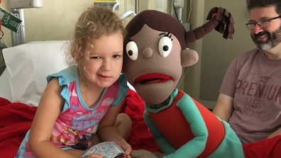 Emily with puppet in hospital