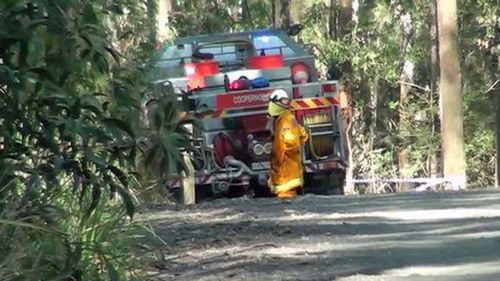 A Rural Fire Services crew was extinguishing a small blaze when they found the remains in bushland.