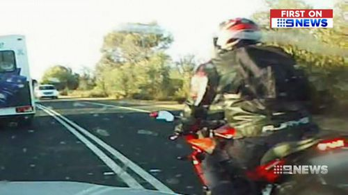 Vision has emerged showing a motorbike rider illegally overtaking vehicles twice within seconds. (9NEWS)