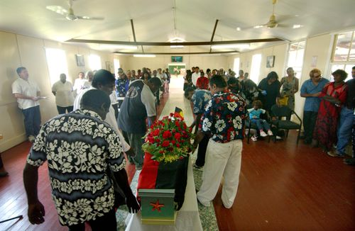 Palm Island locals pay tribute at the funeral of Mulrunji Doomagee in December 2004. (AAP)