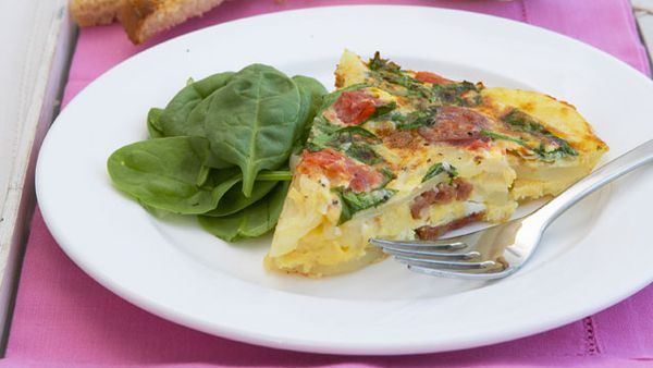 Spanish omelet with roasted tomatoes, spinach and chorizo