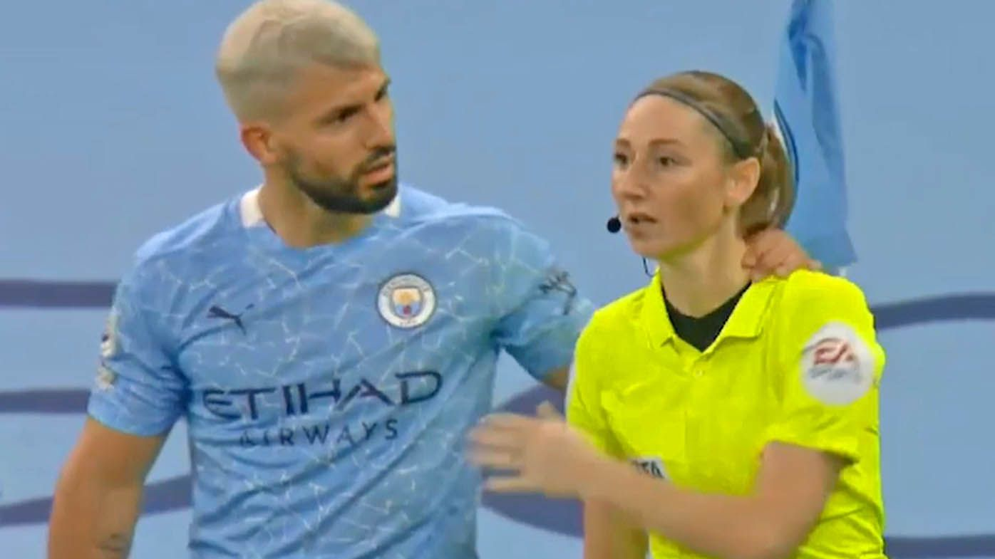 Sergio Aguero grabs a female assistant referee