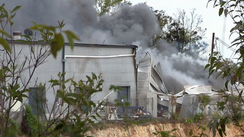 Fire has destroyed a Gold Coast surfboard factory, sending thick black smoke billowing across neighbouring suburbs.
