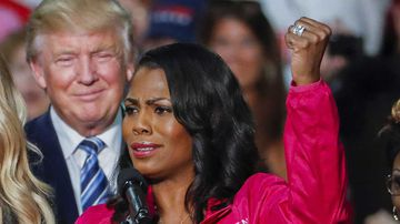 Donald Trump listens to Omarosa Manigault-Newman. (AAP)