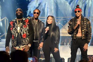 Alsina (right) performs onstage at the American Music Awards in 2016 with Rick Ross, Future and Nicki Minaj.