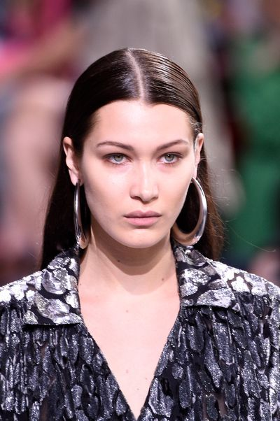 Bella Hadid walking for Marchessa with velvet skin and softest of nude lips.