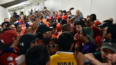 The fans forced entry to the Maracana stadium, despite not having tickets. (Getty)