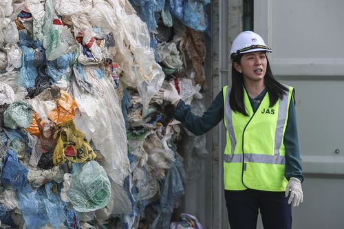 Malaysia's Minister of Energy, Science, Technology, Environment and Climate Change, Yeo Bee Yin shows plastic waste inside a cargo container before it is sent back to the country of origin in Port Klang, Selangor, Malaysia, 28 May 2019.