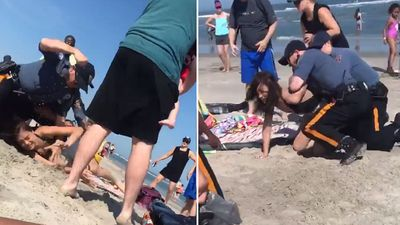 Police investigating video of officers punching woman on beach in US