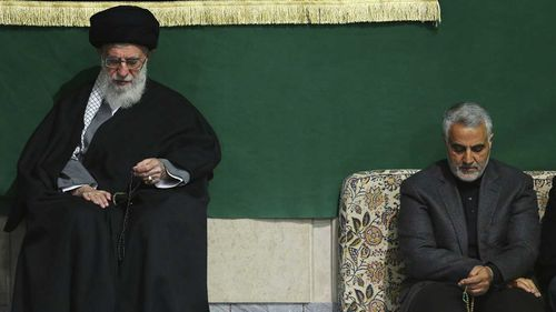 The commander of Iran's Quds Force, Qassem Soleimani, right, sits next to the Supreme Leader Ayatollah Ali Khamenei.