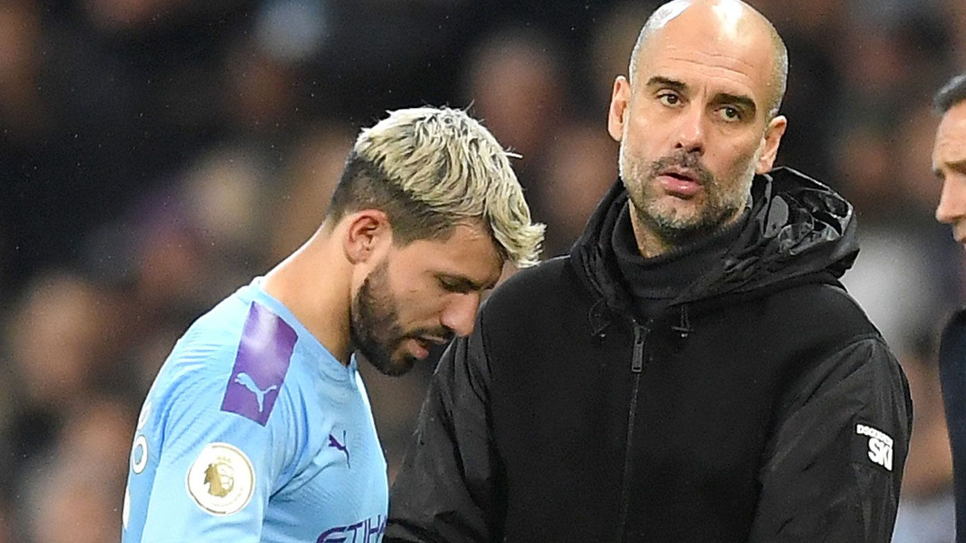 Pep Guardiola, Manager of Manchester City embraces Sergio Aguero
