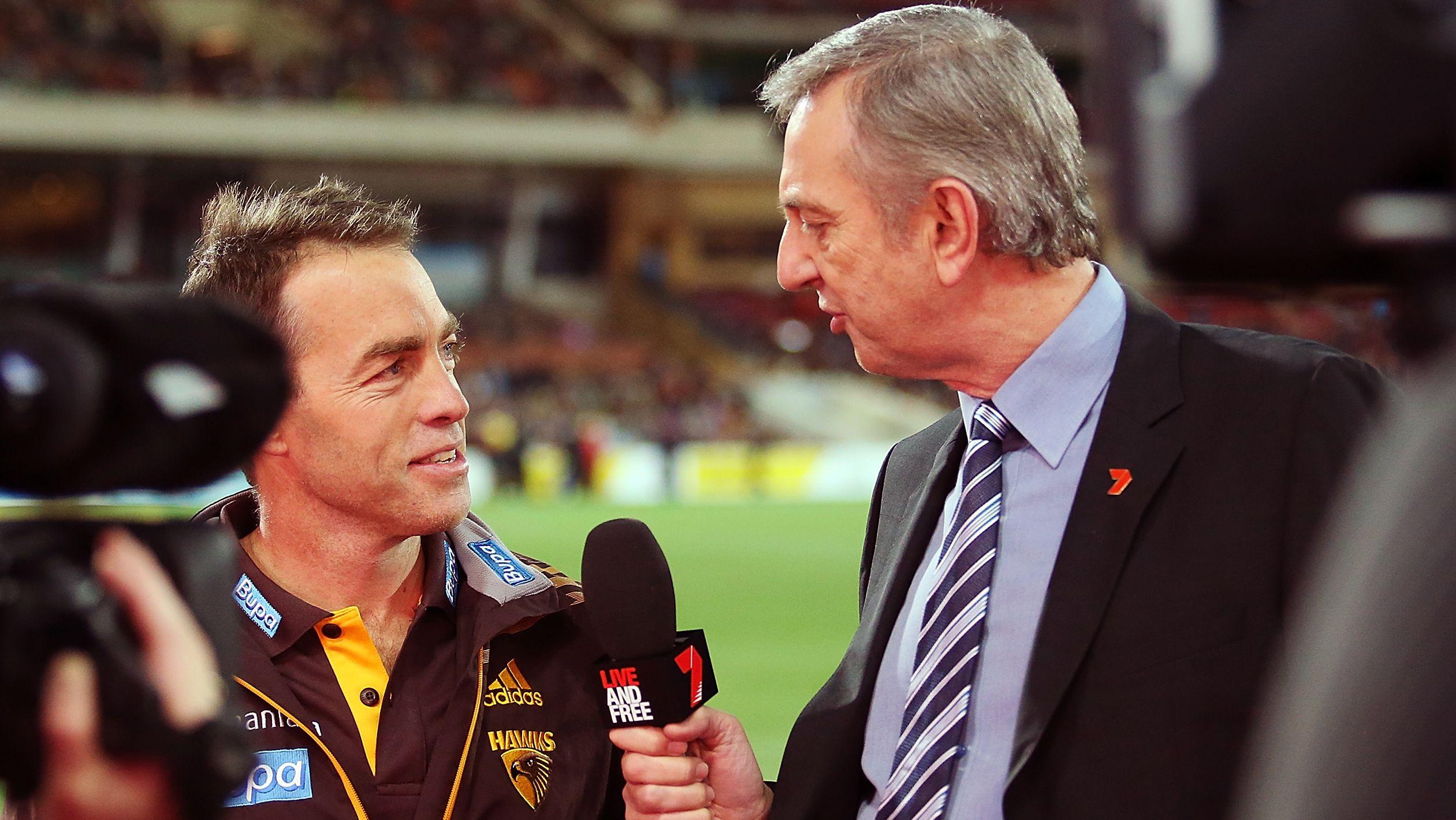 Dennis Cometti interviewing former Hawthorn coach Alastair Clarkson.