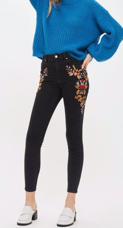 """<a href=""""https://www.theiconic.com.au/moto-folk-embroidered-jamie-jeans-548129.html"""" target=""""_blank"""">Top Shop MOTO Folk Embroidered Jamie Jeans, $99.95.</a>"""