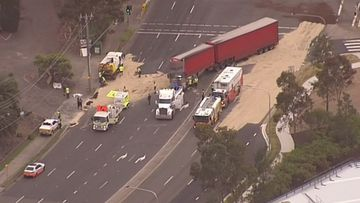 Hazmat crews are now on the scene to clean up the fuel spill as police man local diversions for motorists.