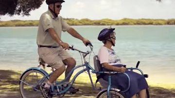 Bill and Glad on their custom-made bike.