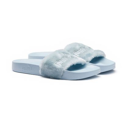 "<p><a href=""https://au.puma.com/explore/puma-x-fenty/fur-women-s-slide-sandals-365772-03.html?style=365772_03"" target=""_blank"">Puma X Fenty Fur Women's Slide Sandals in Cool Blue-Puma Silver, $120</a></p>"