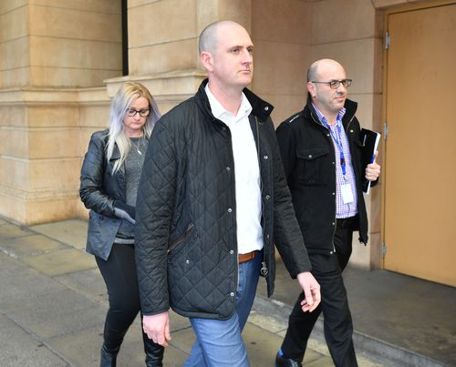 The husband of Lucy Paveley, Jaime (centre) and Cindy Juel-Chapman (left) are seen outside the District Court in Adelaide.