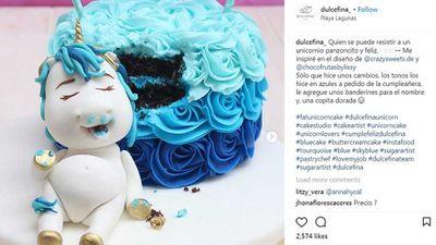 Pudgy unicorn rests on baby blue unicorn cake