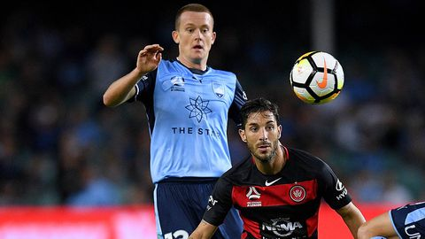 Michael Zulloof Sydney competes for possession with Alvaro Cejudo of the Wanderers
