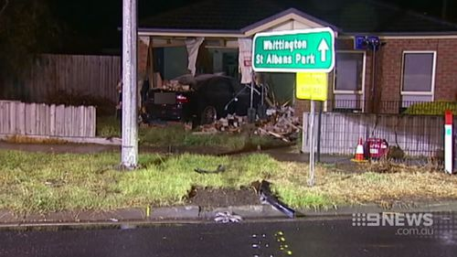 The car smashed through a fence before hitting the house. (9NEWS)