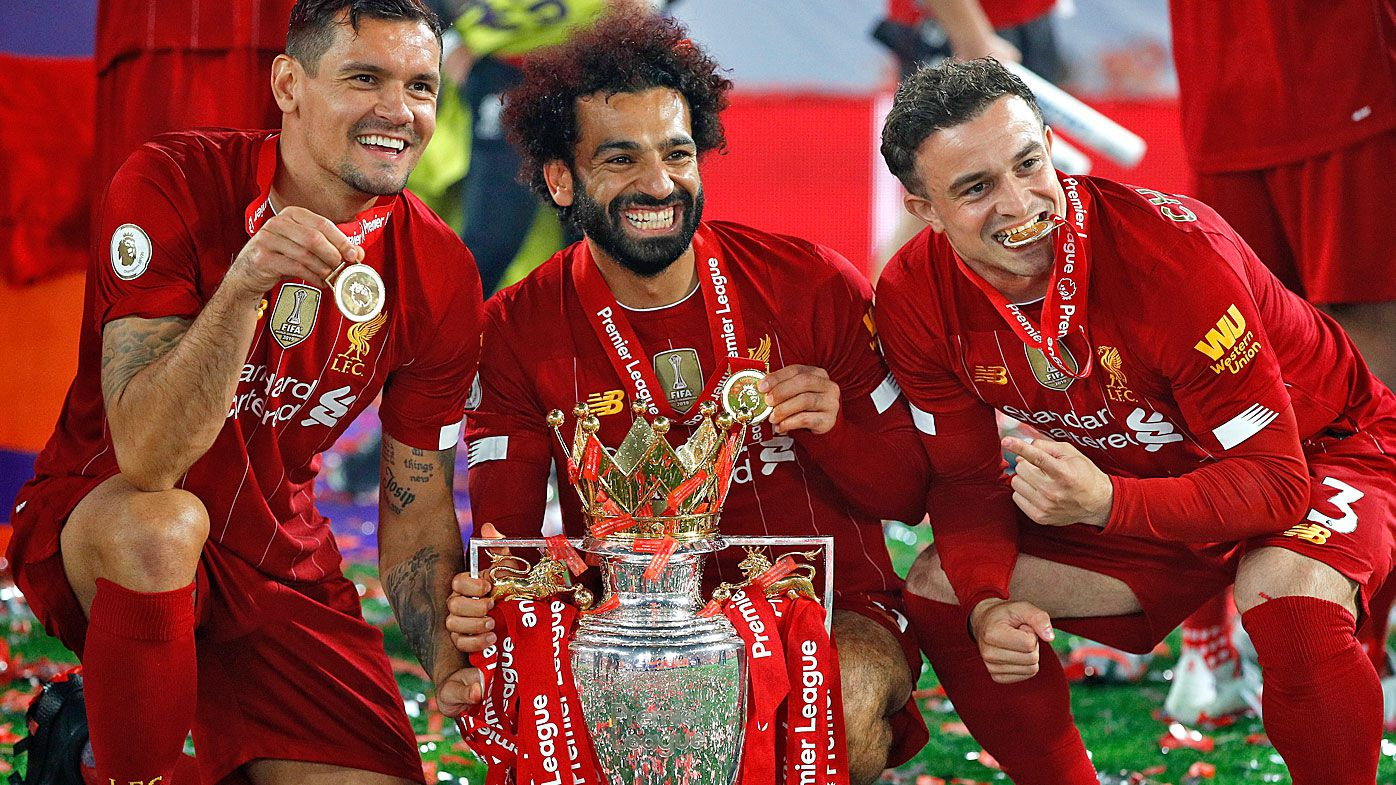 Dejan Lovren, Mohamed Salah and Xherdan Shaqiri of Liverpool celebrate with The Premier League trophy