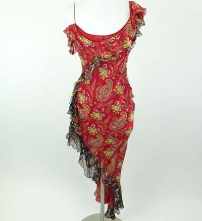 """Kim Kardashian West <a href=""""https://www.ebay.com/itm/Kim-Kardashian-West-CHRISTIAN-DIOR-Red-Multicolor-Silk-Dress-Size-10/142682184504?_trkparms=%26rpp_cid%3D58a24ca2e4b0fa4552d36ff2%26rpp_icid%3D58a24b82e4b04206a7b801b5"""" target=""""_blank"""" draggable=""""false"""">CHRISTIAN DIOR Red/Multicolor SilkDress</a> Size 10, current bid, $511.79"""