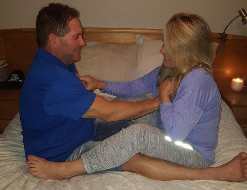 Sharleen Orlando demonstrates with her husband.