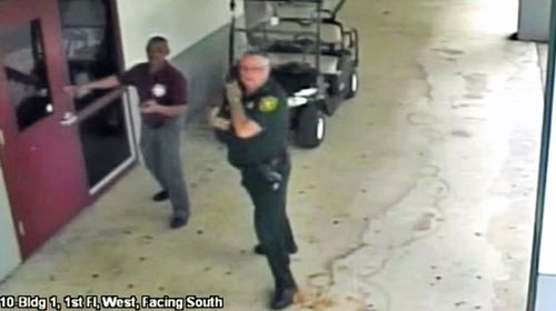 CCTV images showed Scot Peterson during the high school shooting in Florida. (Photo: AP).