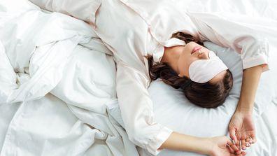 Woman sleeping with sleep mask