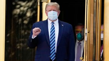 President Donald Trump walks out of Walter Reed National Military Medical Center to return to the White House after receiving treatments for COVID-19