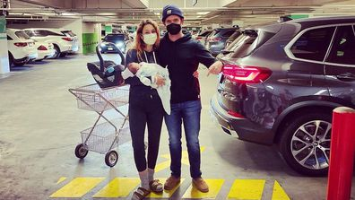 Troian Bellisario and and Patrick J. Adams welcomed their baby in a car park.