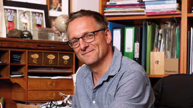 Dr Michael Mosley sitting in an office