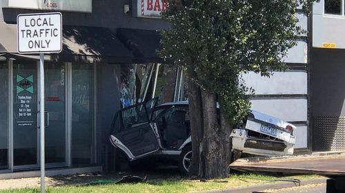 The offending vehicle smashed into the barber shop in Altona North this afternoon.