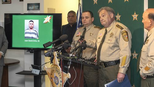 Webb County Sheriff's Office Chief Deputy Frederico Garza (second from right) debriefs media about Ortiz's arrest.