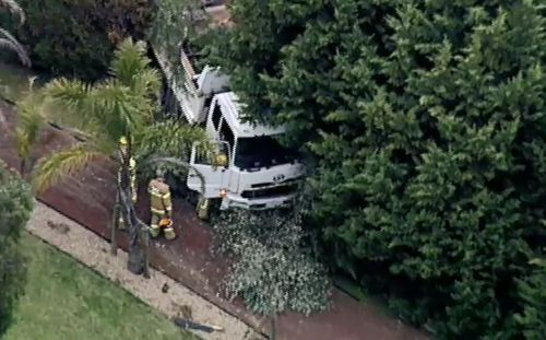 A truck carrying an excavator crashed into a pedestrian in Donvale.