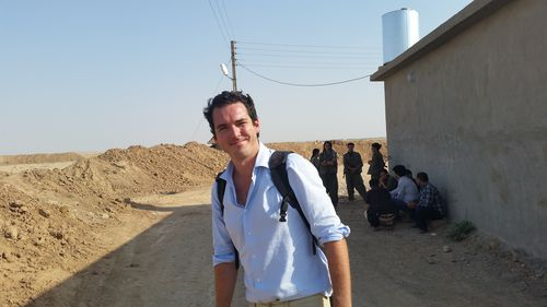 Reporter Peter Stefanovic pictured at a PKK compound south of Kirkuk. Picture: 9NEWS
