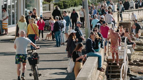 Crowds flock to enjoy the sunshine in Manly, Sydney over the weekend, despite the city being plunged into lockdown.