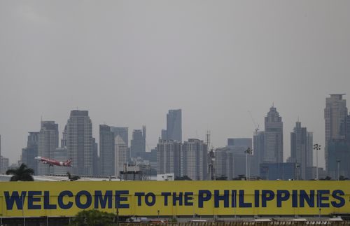 Heavy cloud fills the sky above Manila, which is in the north of the Philippines - the area likely to be worst affected.